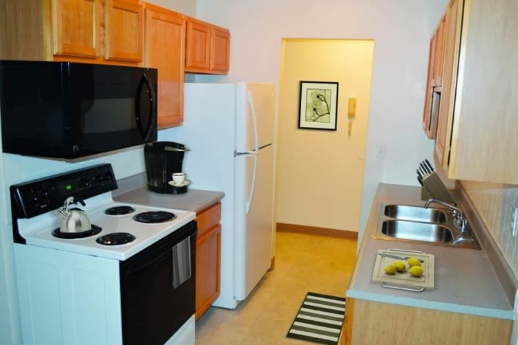 Well-equipped kitchen at Lake Vista Apartments in Rochester, NY
