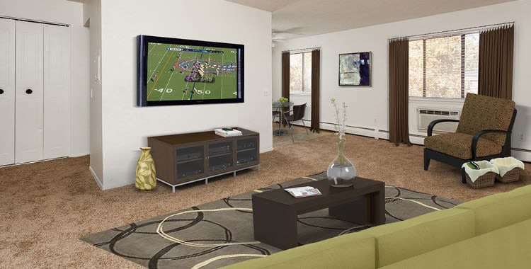 Enjoy a cozy living room at Parkway Manor Apartments