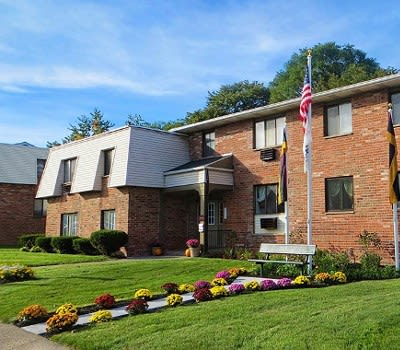 Exterior view of the apartments at Parkway Manor Apartments in Rochester, NY