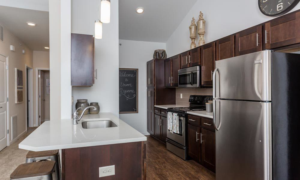 Union Square Apartments offers a modern kitchen in North Chili, NY