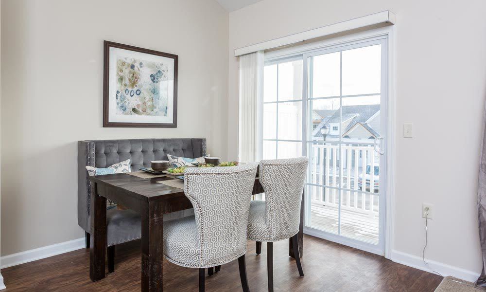 Elegant dining room at Union Square Apartments in North Chili, New York