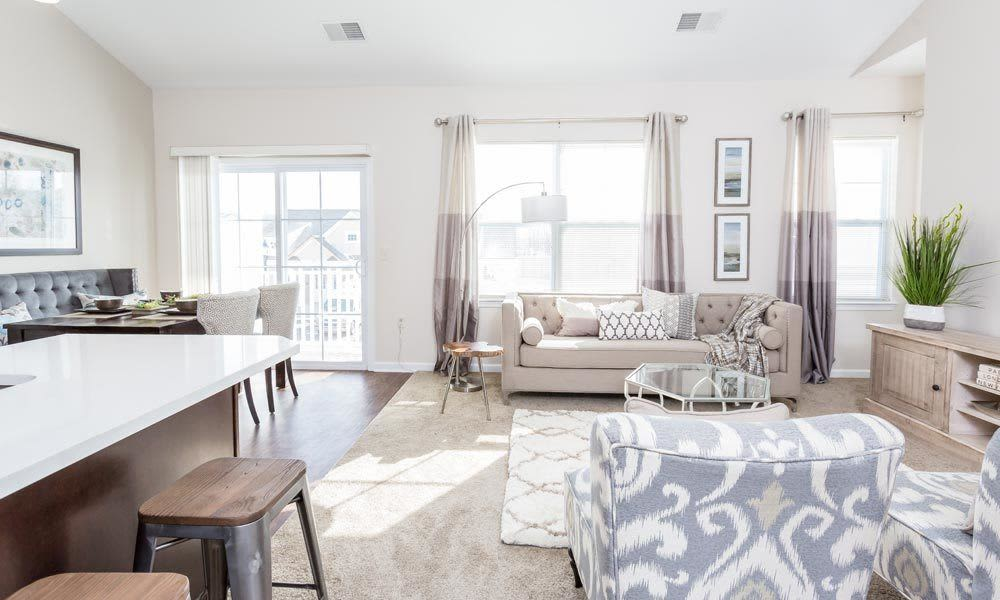 Cozy living room at Union Square Apartments in North Chili