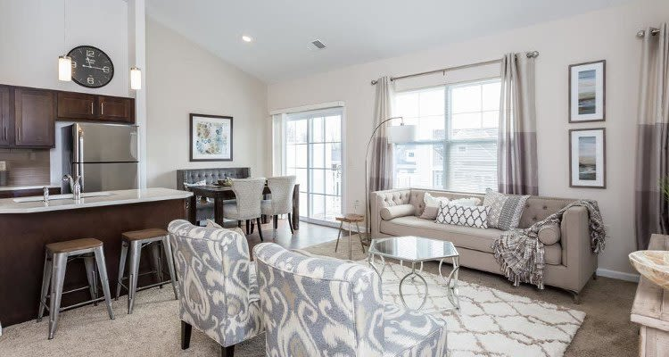 Beautifully designed living room at Union Square Apartments in North Chili, New York
