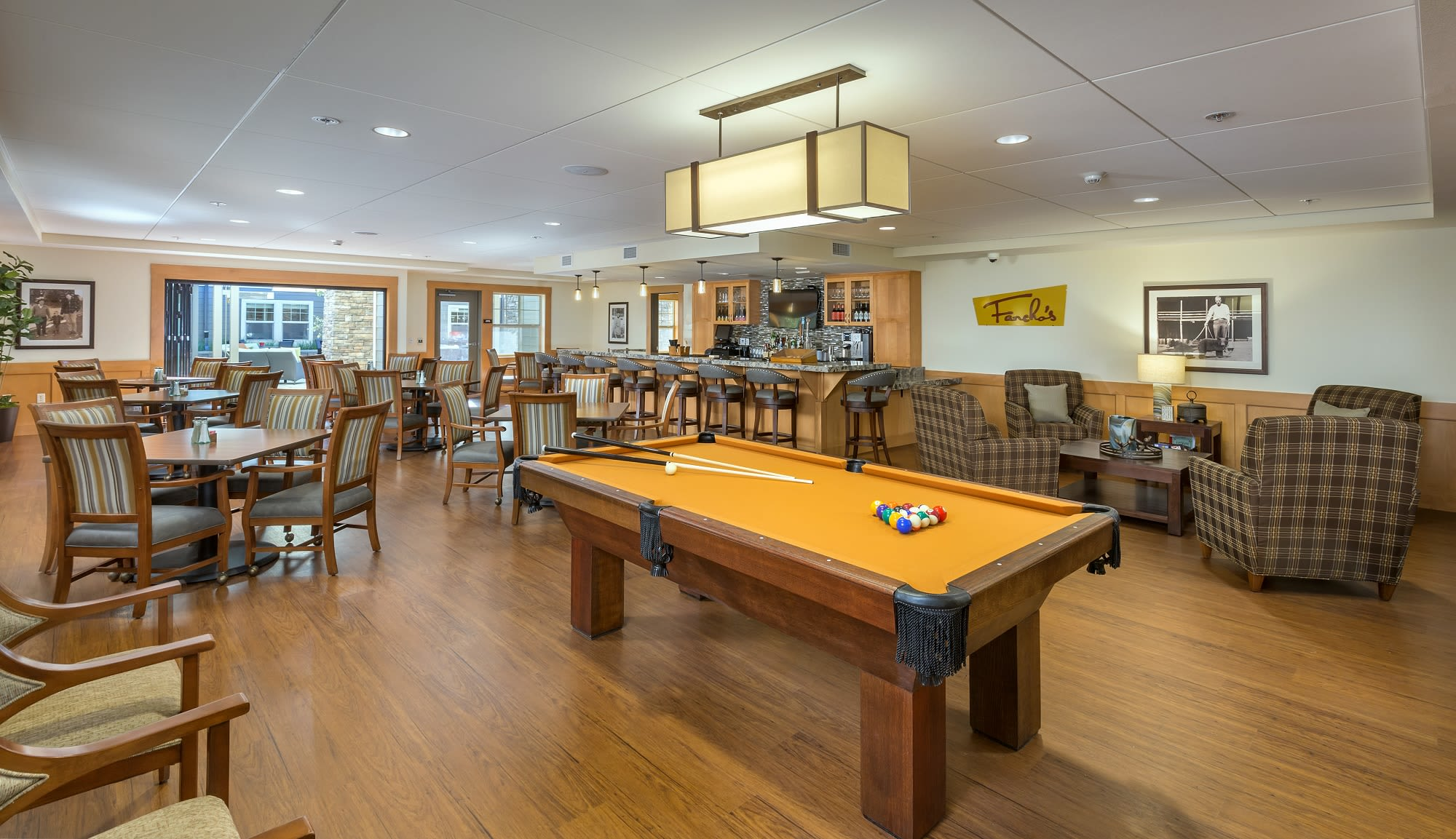 Enjoy a drink with friends in the pub at our senior living community in Eugene Oregon