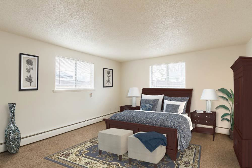 Enjoy a bedroom at Dixon Manor luxury apartments
