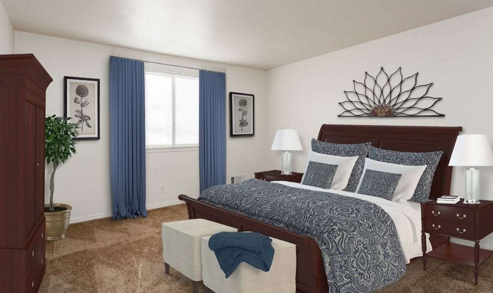 Luxury bedroom at East Ridge Manor Apartments in Rochester
