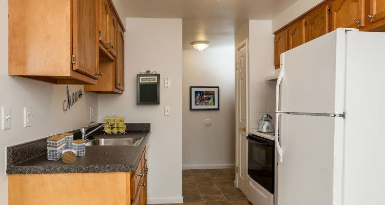Fully-equipped kitchen at East Ridge Manor Apartments in Rochester