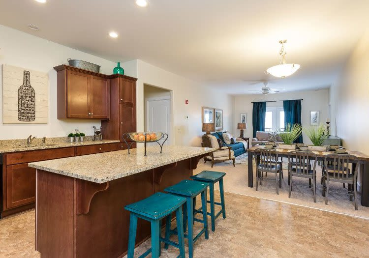 Our apartments in Rochester, New York showcase a beautiful kitchen and breakfast bar