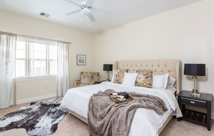 Beautifully designed bedroom at Gateway Landing on the Canal in Rochester