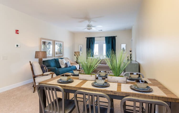 Elegant dining room and spacious living room at Gateway Landing on the Canal