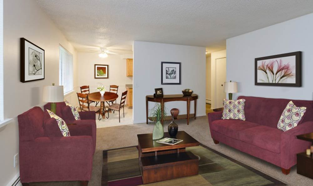 Spacious living room at Glenbrook Manor Apartments home in Rochester, NY