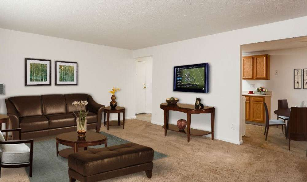 Beautifully designed living room at King's Court Manor Apartments in Rochester