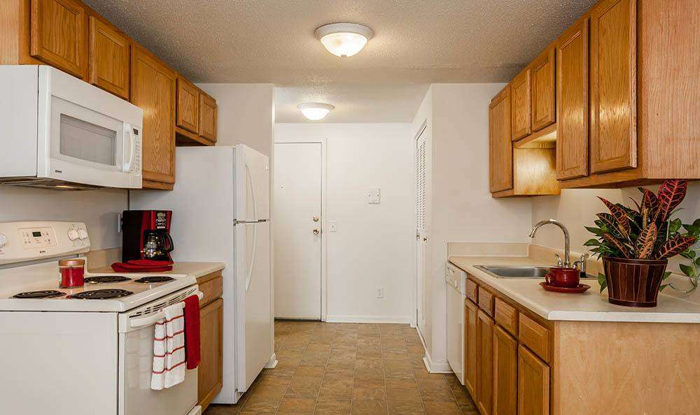 Fully-equipped kitchen at King's Court Manor Apartments in Rochester