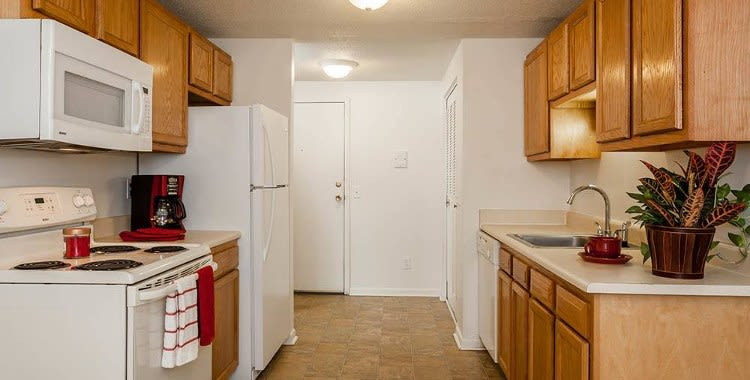 Enjoy a kitchen at King's Court Manor Apartments luxury apartments