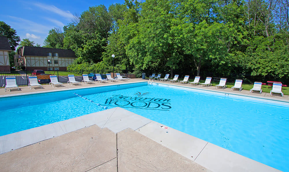 View of the swimming pool and ample poolside seating at Bavarian Woods in Middletown