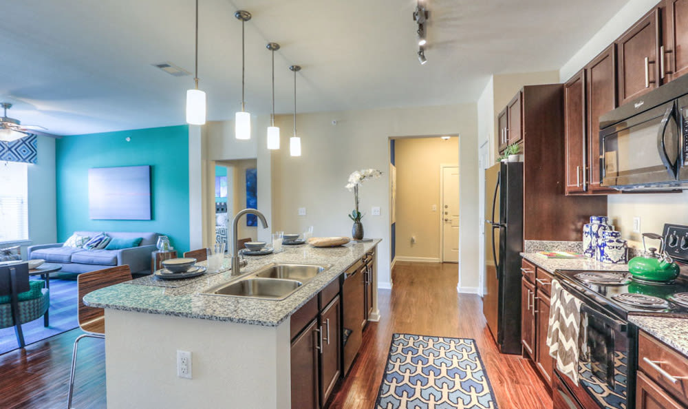 Kitchen with View of living room at Victory North Apartments