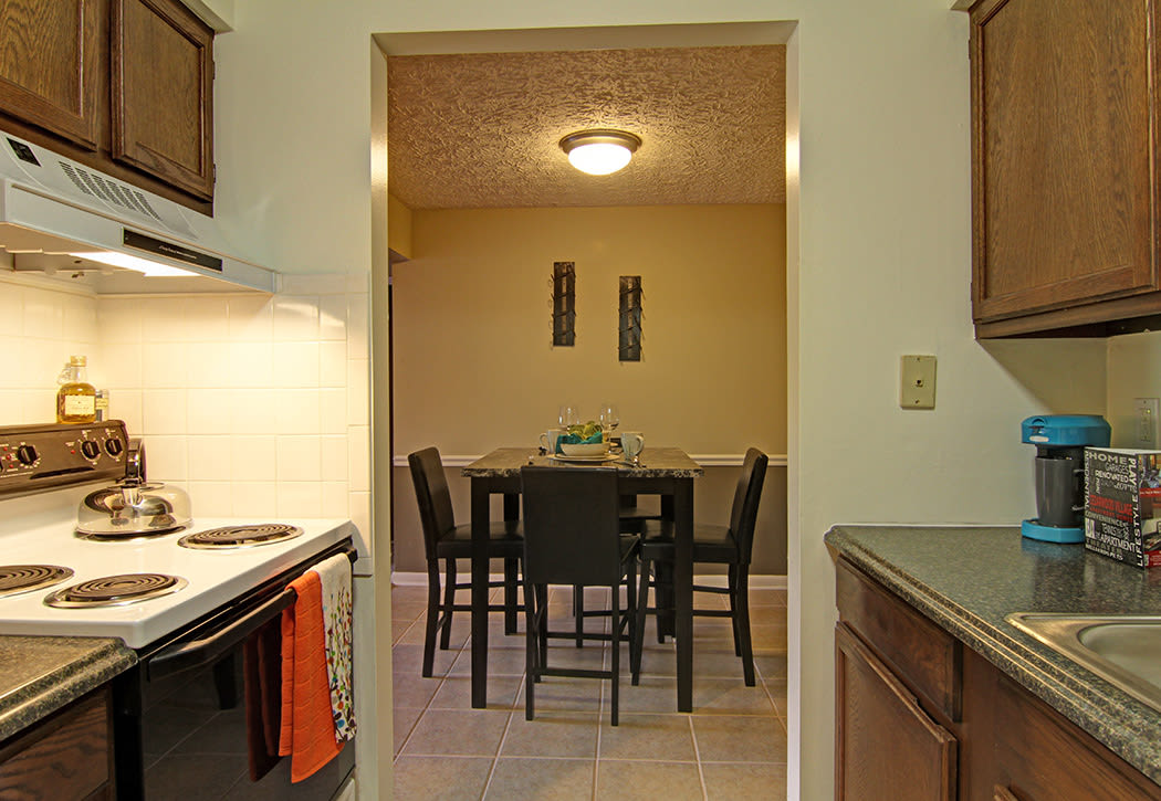 Modern kitchen with all the conveniences you need at Cedarwood Village Apartments in Akron