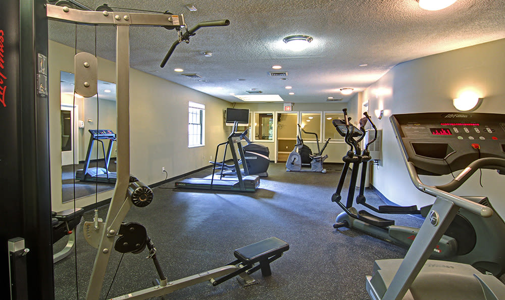 Well-equipped on-site fitness center at Cedarwood Village Apartments in Akron