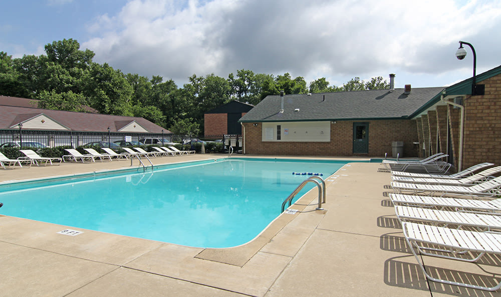 Swimming pool area at Cedarwood Village Apartments in Akron