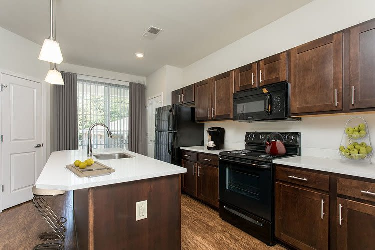 Upgraded kitchen with island at Green Lake Apartments in Orchard Park, NY