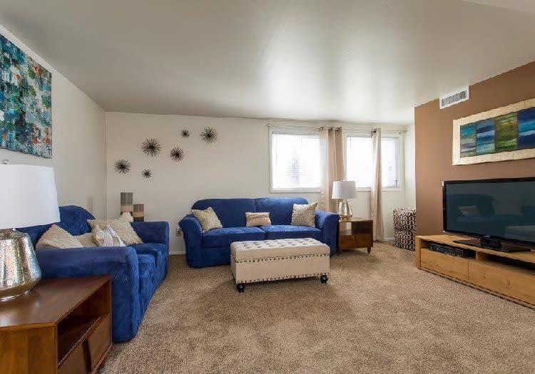 Cozy living room at Idylwood Resort Apartments in Cheektowaga, New York