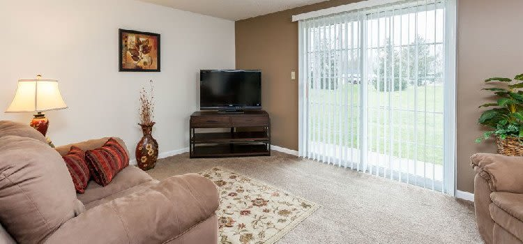 Spacious living room at Maplewood Estates Apartments home