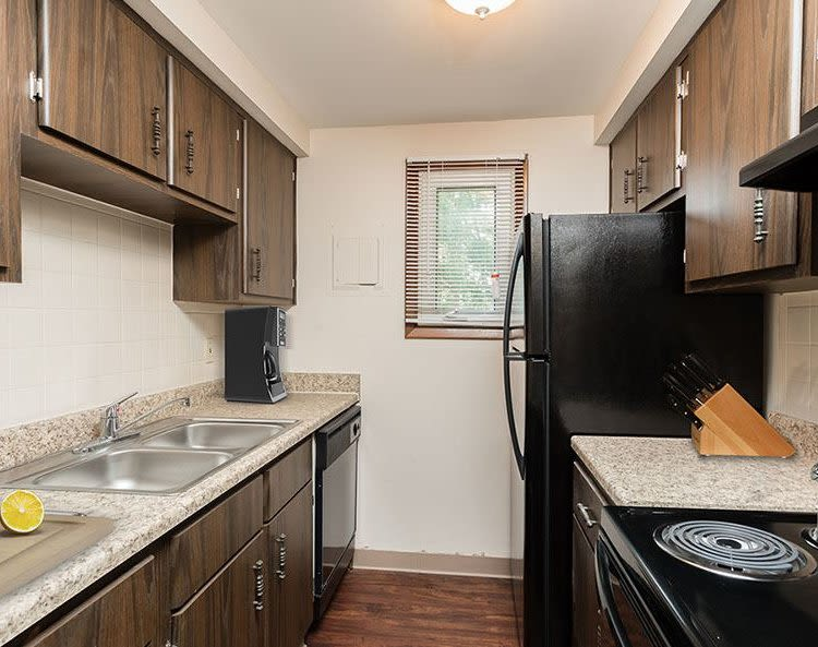Well-equipped kitchen at Paradise Lane Apartments home in Tonawanda, New York