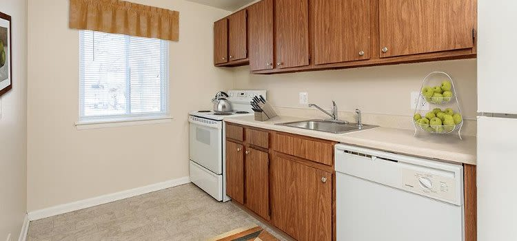 Well-equipped kitchen at Willowbrooke Apartments and Townhomes home