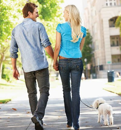 Couple walking at Willowbrooke Apartments and Townhomes in Brockport, New York