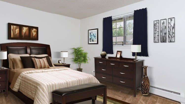 Well decorated bedroom at Creek Hill Apartments & White Oak Apartments home in Webster