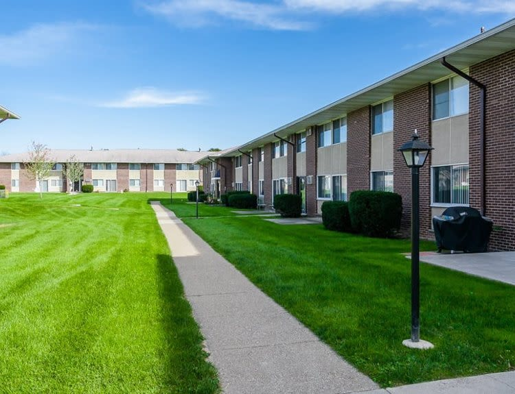 Exterior view of apartments at Creek Hill Apartments & White Oak Apartments in Webster, NY