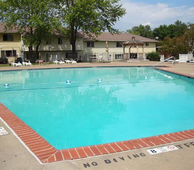 Sparkling swimming pool at Elmwood Terrace Apartments & Townhomes in Rochester, New York
