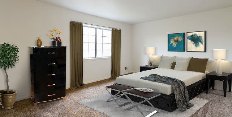 Well decorated bedroom at Elmwood Terrace Apartments and Townhomes home in Rochester