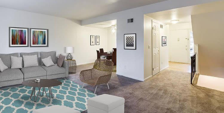 Spacious living room at Elmwood Terrace Apartments and Townhomes home