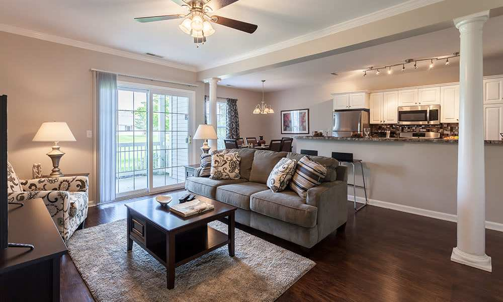 Spacious living room at Oakmonte Apartments in Webster