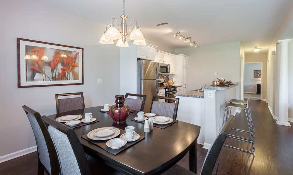 Dining room at Oakmonte Apartments in Webster