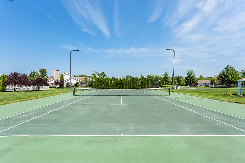 Tennis court at Oakmonte Apartments in Webster