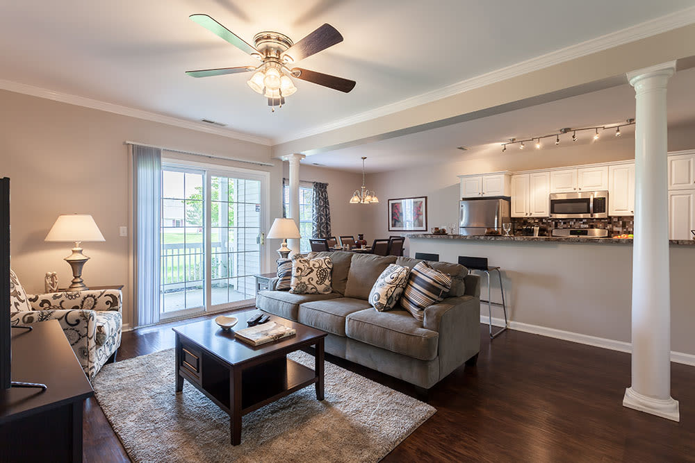Spacious living room at Oakmonte Apartments in Webster, NY
