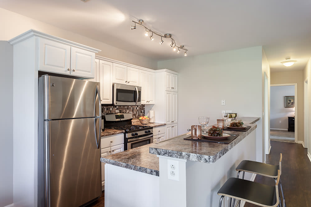 Modern kitchen at Oakmonte Apartments in Webster, NY