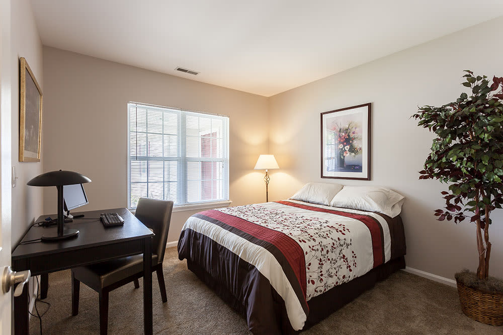 Cozy bedroom at Oakmonte Apartments home in Webster, NY