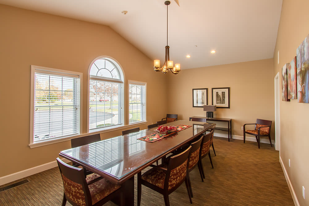 Clubhouse dining table at Oakmonte Apartments in Webster
