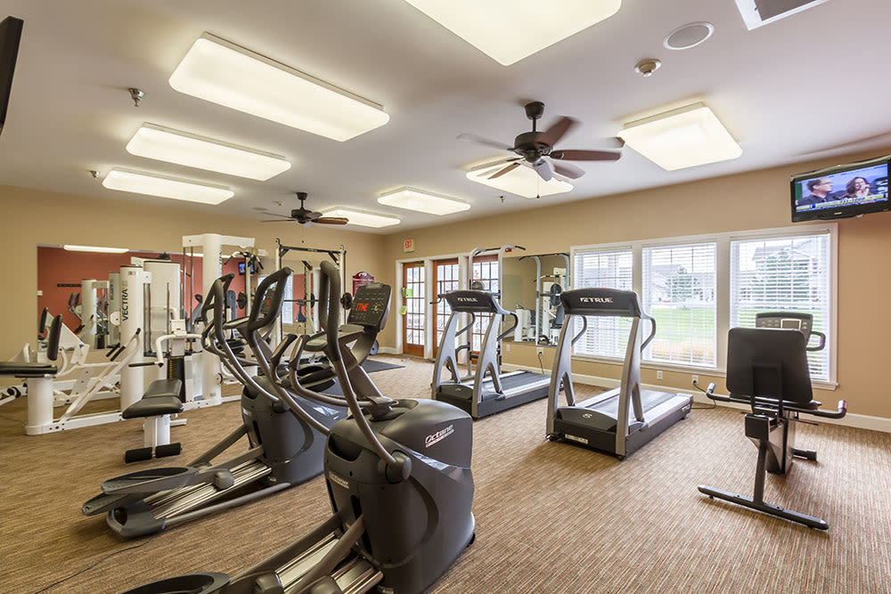 Fitness center at Oakmonte Apartments in Webster