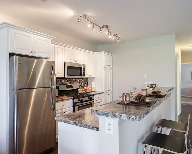 Fully-equipped kitchen at Oakmonte Apartments home