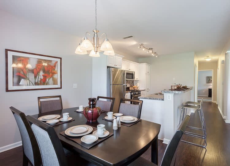 Dining room at Oakmonte Apartments home