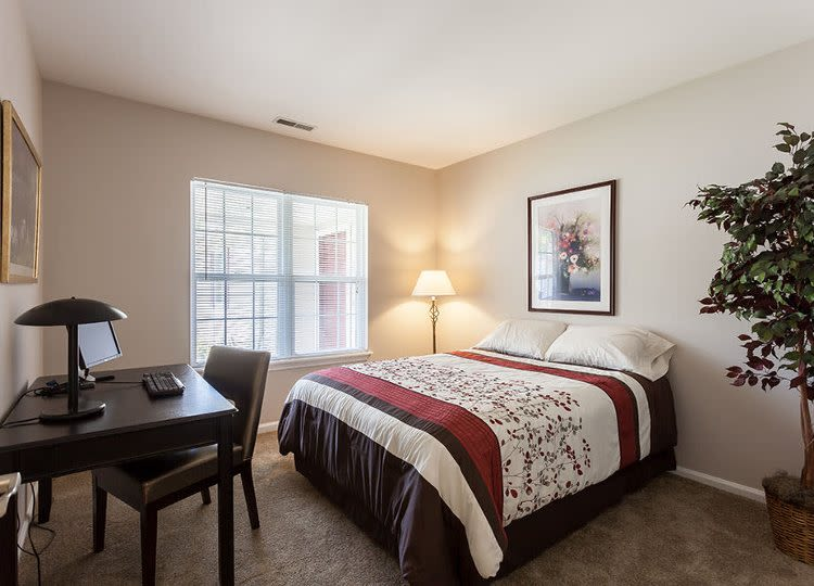 Oakmonte Apartments offers a cozy bedroom in Webster, NY