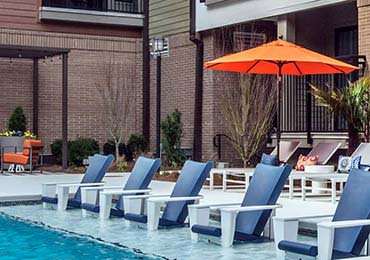 Poolside lounge chairs at 675 N Highland