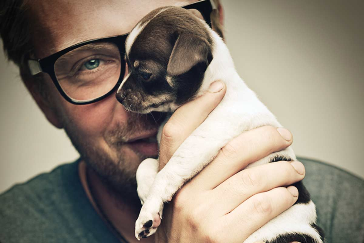 Man holding puppy at VIA