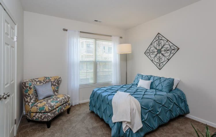 Well decorated bedroom at Auburn Creek Apartments home in Victor
