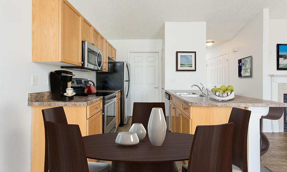 Well-equipped kitchen and dining room at Avon Commons in Avon
