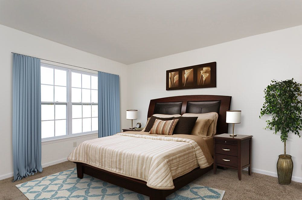 Renovated bedroom at apartments & townhomes in Avon, NY